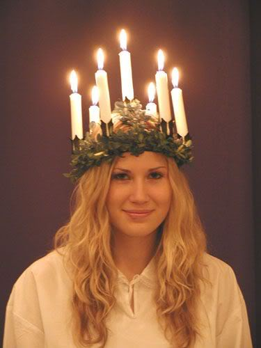 Swedish girl as Saint Lucia wearing a crown of candles