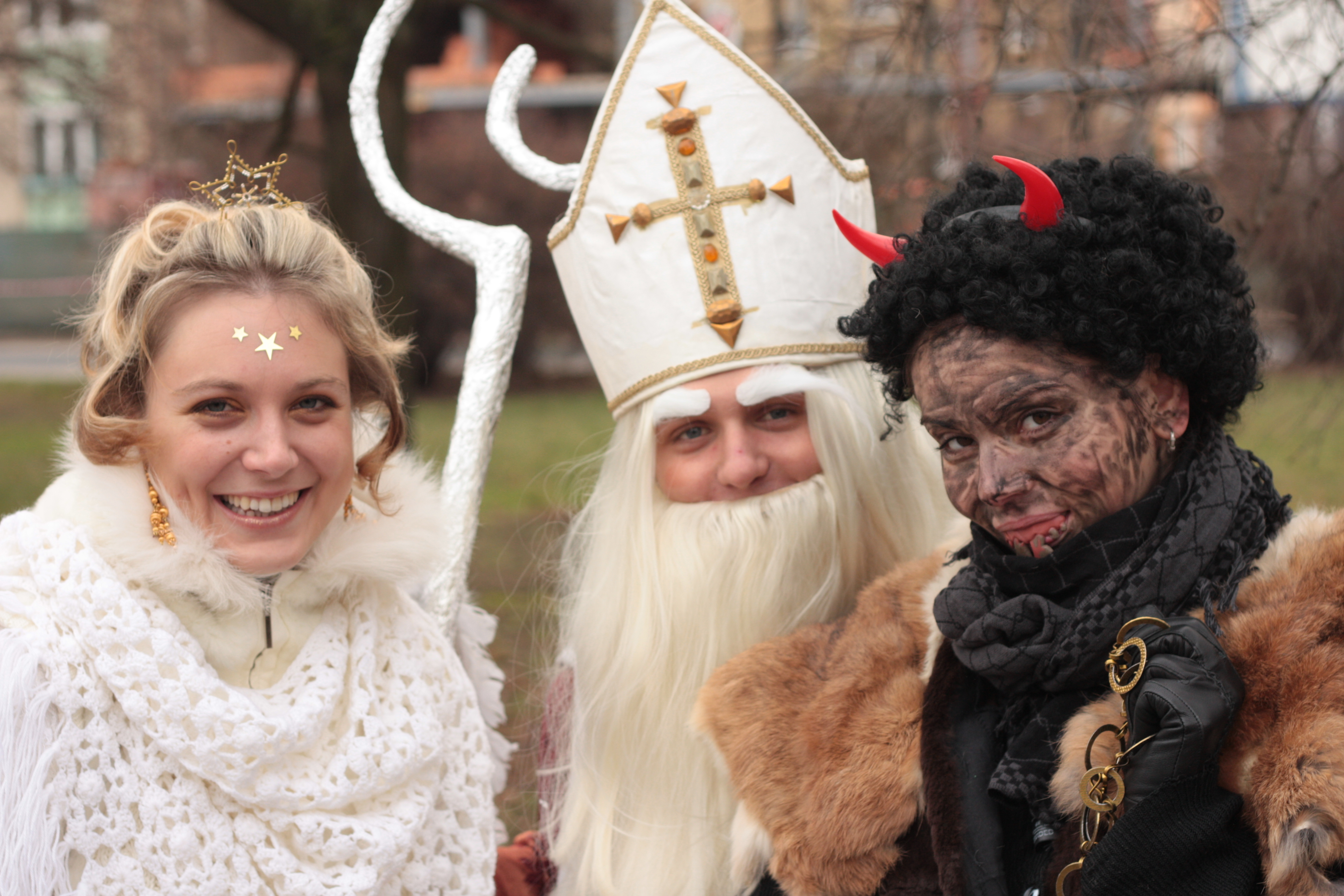 Saint Nicholas with an angel and a devil