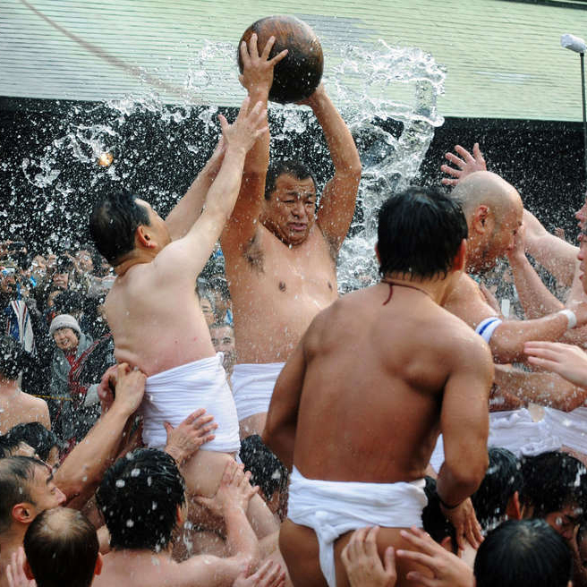 Men compete for a treasure ball at Tamaseseri Festival in Japan