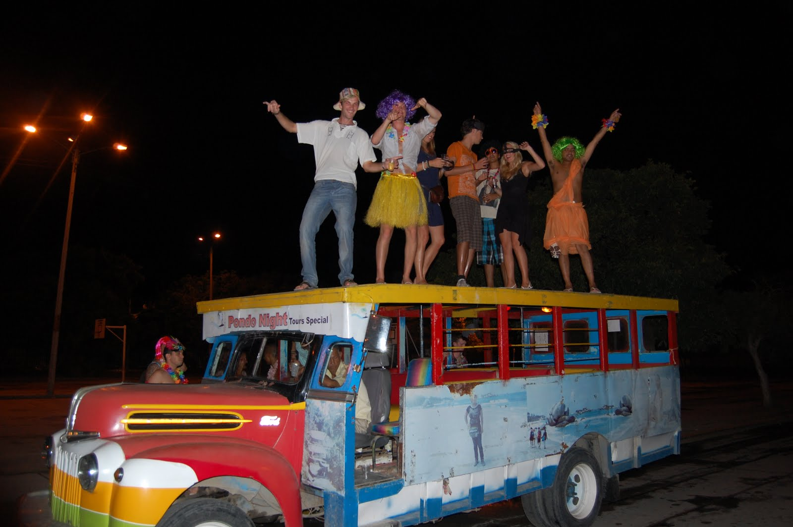 People dancing on a chiva bus on Halloween