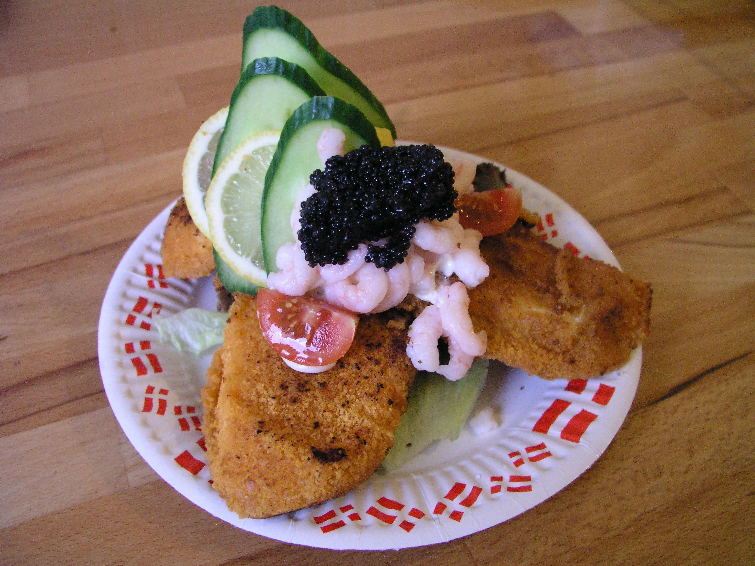 Dish showing a delicious Danish sandwich